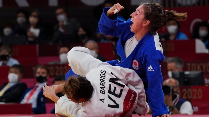 Canada's Catherine Beauchemin-Pinard reacts after defeating Anriquelis Barrios of Venezuela to win the bronze medal in the Women Judo 63kg during the Tokyo Olympics in Japan on Tuesday, July 27, 2021. THE CANADIAN PRESS/Nathan Denette