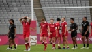 Team Canada members walk off the pitch after losing to New Zealand in their men's rugby sevens quarterfinal match at the 2020 Summer Olympics, July 27, 2021 in Tokyo, Japan. (AP Photo/Shuji Kajiyama)