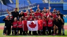 Members of Team Canada pose for photographs after a softball game against Mexico at the 2020 Summer Olympics, July 27, 2021, in Yokohama, Japan. Canada won 3-2. (AP Photo/Sue Ogrocki)