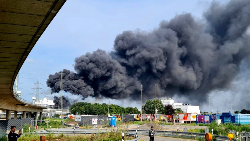 A dark cloud of smoke rises above the chemical park in Leverkusen, Germany, Tuesday, July 27, 2021. (Mirko Wolf/dpa via AP)