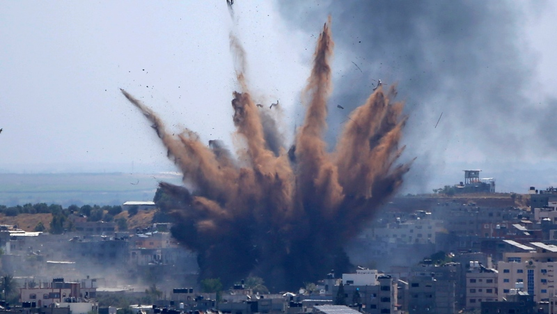 In this May 13, 2021, file photo, smoke rises following Israeli airstrikes on a building in Gaza City. (AP Photo/Hatem Moussa, File)