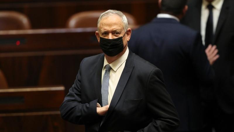 Israeli politician Benny Gantz stands during a Knesset session in Jerusalem Sunday, June 13, 2021. (AP Photo/Ariel Schali22)