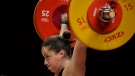 Canada's Maude Charron competes in the women's 64kg weightlifting event, at the 2020 Summer Olympics, July 27, 2021, in Tokyo, Japan. (AP Photo/Luca Bruno)