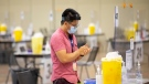 A health-care worker sanitizes his hands before doors open at a COVID-19 vaccine centre in Toronto on Friday, July 23, 2021. THE CANADIAN PRESS/Chris Young