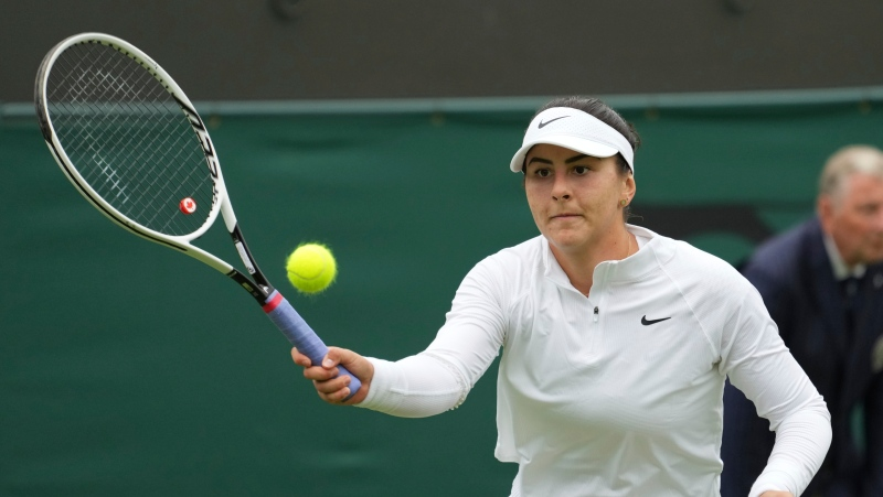 Canada's Bianca Andreescu plays a return to Alize Cornet of France during the women's singles first round match on day three of the Wimbledon Tennis Championships in London, Wednesday June 30, 2021. (AP Photo/Alberto Pezzali)