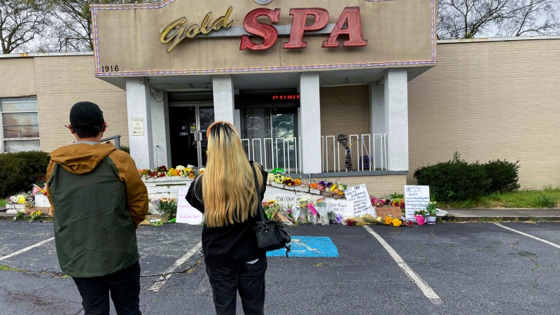 People view a makeshift memorial on Friday, March 19, 2021, in Atlanta. (AP Photo/Candice Choi)