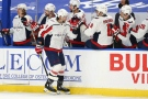 Washington Capitals defenseman Brenden Dillon (4) celebrates his goal during the first period of an NHL hockey game against the Buffalo Sabres, Friday, April 9, 2021, in Buffalo, N.Y. (AP Photo/Jeffrey T. Barnes)