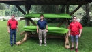 Brian Beecham of St. Mary Home Hardware, Mayor Al Strathdee of St. Marys, and Christopher Swarthout of the local Kinsmen Club stand in-front of the 'Yak Shack', where people can access free kayak rentals. (Sean Irvine CTV News)