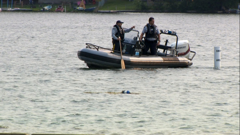 RCMP officers searching Chestermere Lake after a man went missing and is now presumed drowned.