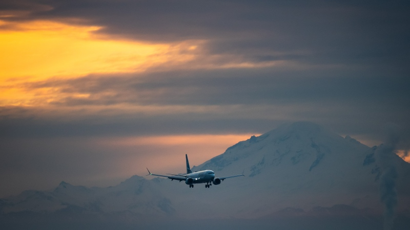 Mount Baker in Washington is seen in the distance as a WestJet Airlines Boeing 737 Max aircraft arrives at Vancouver International Airport in Richmond, B.C., on Thursday, Jan. 21, 2021. (Darryl Dyck / THE CANADIAN PRESS)