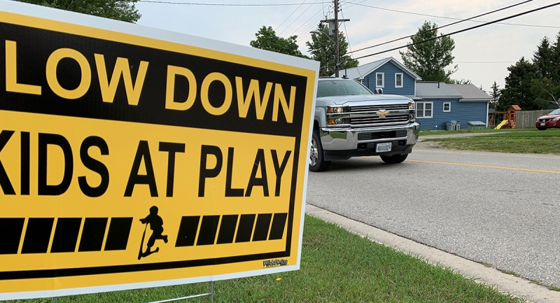 A sign asks drivers to slow down in Crediton, Ont. on Tuesday, July 27, 2021. (Bryan Bicknell / CTV News)