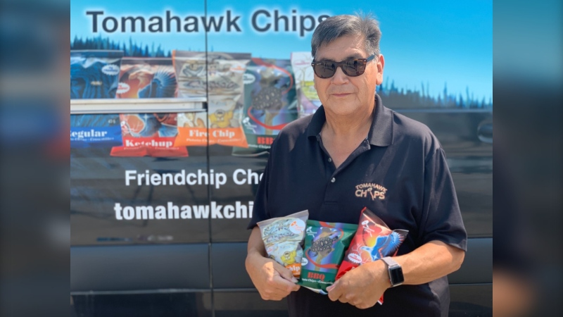 Alfred Lea holding bags of Tomahawk Chips that will soon be sold throughout Canada. July 27, 2021. (Source: Scott Andersson/CTV News)