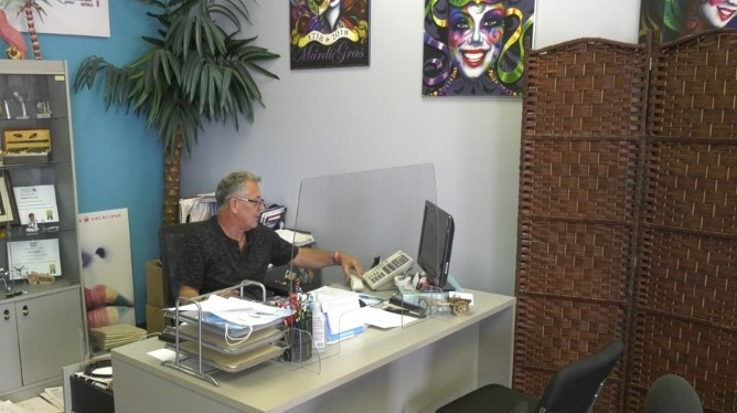 Tecumseh Travel owner Michael Horvath reopens his office in Tecumseh, Ont., Tuesday, July 27, 2021. (Melanie Borrelli / CTV WIndsor)