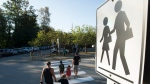 Children walk with their parents to Sherwood Park Elementary in North Vancouver for the first day back-to-school Thursday, September 10, 2020. (THE CANADIAN PRESS/Jonathan Hayward)