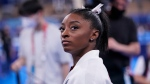 Simone Biles, waits for her turn to perform during the artistic gymnastics women's final at the 2020 Summer Olympics, Tuesday, July 27, 2021, in Tokyo. (AP Photo/Gregory Bull)