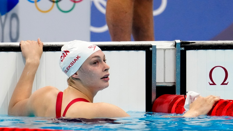Canada's Penny Oleksiak looks at her results in the women's 200m freestyle semifinal event during the Tokyo Summer Olympic Games, in Tokyo, Tuesday, July 27, 2021. THE CANADIAN PRESS/Frank Gunn