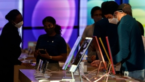 Workers and customers wear masks inside an Apple Store amid the COVID-19 Pandemic on The Promenade Wednesday, June 9, 2021, in Santa Monica, Calif. (AP Photo/Marcio Jose Sanchez)