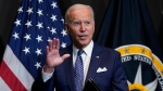 U.S. President Joe Biden finishes leaves after speaking during a visits to the Office of the Director of National Intelligence in McLean, Va., Tuesday, July 27, 2021. (AP Photo/Susan Walsh)