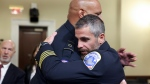 Washington Metropolitan Police Department officer Michael Fanone, right hugs U.S. Capitol Police Sgt. Harry Dunn after a House select committee hearing on the Jan. 6 attack on Capitol Hill in Washington, Tuesday, July 27, 2021. (Jim Lo Scalzo/Pool via AP)