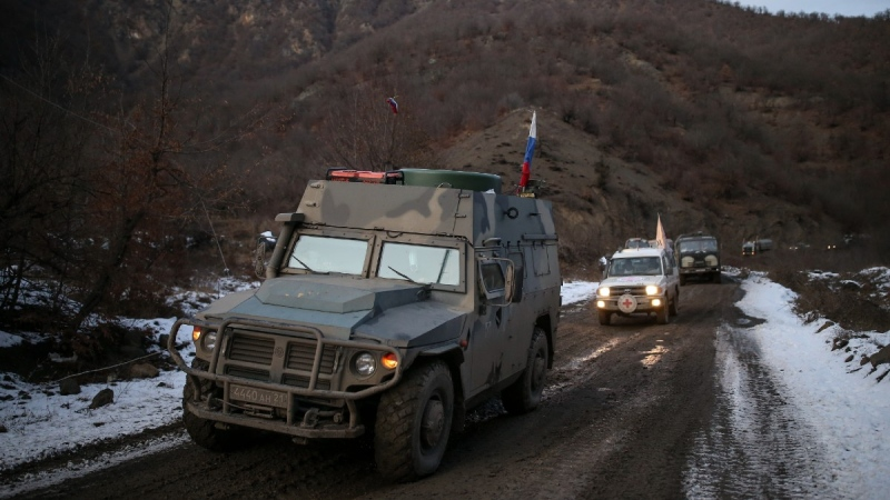 Russian peacekeepers' and Azerbaijan's military vehicles roll along a highway near Kalbajar, Azerbaijan, on Dec. 2, 2020. (Emrah Gurel / AP)