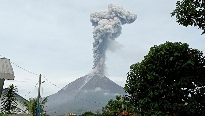 Mount Sinabung releases volcanic materials during an eruption in Karo, North Sumatra, Indonesia, Friday, May 7, 2021. (AP Photo/Sastrawan Ginting)