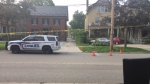 Police on scene 100 metres east of Waterloo Street at Dufferin Avenue in London, Ont. on Wednesday, July 28, 2021. (Marek Sutherland / CTV News)