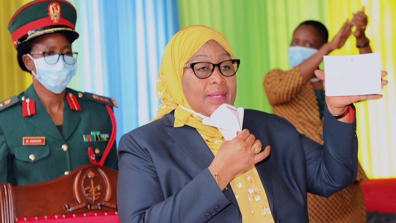 Tanzanian president Samia Suluhu Hassan holds her vaccination certificate after she was vaccinated in Dodoma, Tanzania, July 28, 2021. (AP Photo/Domasa Sylivester)