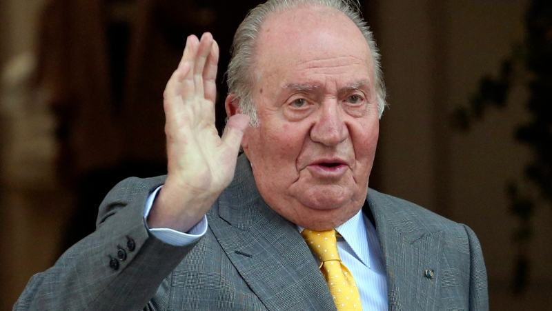 In this March 10, 2018, file photo, Spain's former emeritus King Juan Carlos waves upon his arrival to the Academia Diplomatica de Chile, in Santiago where he met with President-elect Sebastian Pinera. (AP Photo/Esteban Felix, File)