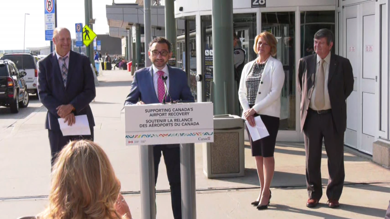 Federal Transport Minister Omar Alghabra speaks at Edmonton International Airport on July 27, 2021, alongside Leduc Mayor Bob Young (left), Leduc County Mayor Tanni Doblanko (second from right), and EIA president and CEO Tom Ruth. The officials announced EIA would receive about $49 million in federal dollars to offset COVID-19's impact.