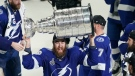 Tampa Bay Lightning defenseman David Savard hoists the Stanley Cup after the series win in Game 5 of the NHL hockey Stanley Cup finals against the Montreal Canadiens, Wednesday, July 7, 2021, in Tampa, Fla. (AP Photo/Gerry Broome)