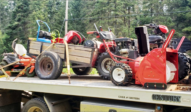 Recovered items include an ATV and a riding lawnmower, both with identification numbers removed. Police also found 88 power tools and construction equipment, a utility trailer and a snowblower. (Supplied)