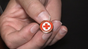 A 'COVID-19 vaccinated' pin is seen at O'Neil Funeral Home in London, Ont. on Wednesday, July 28, 2021. (Jordyn Read / CTV News)