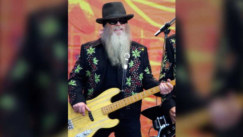Dusty Hill, of ZZ Top, performs during the Crossroads Guitar Festival on June 26, 2010, in Chicago. ZZ Top has announced that Hill, one of the Texas blues trio's bearded figures and bassist, has died at his Houston home. He was 72. In a Facebook post, bandmates Billy Gibbons and Frank Beard revealed Wednesday, July 29, 2021, that Hill had died in his sleep. (AP Photo/Kiichiro Sato, File)