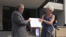 London Mayor Ed Holder accepts the city's 'Blue Community' certification on Wednesday, July 28, 2021. (Daryl Newcombe / CTV News)