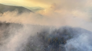 Smoke is seen coming off the Renata Creek wildfire in an image shared by the B.C. Wildfire Service on July 21, 2021.