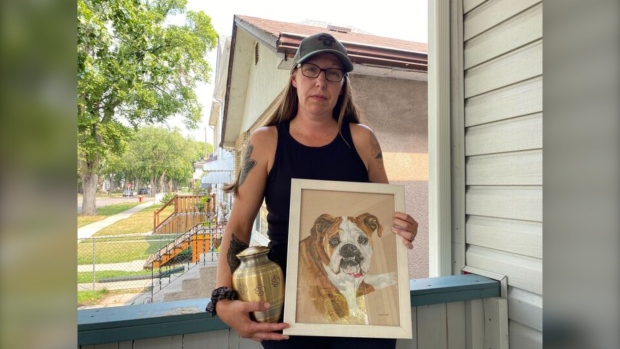 A photo of Tannis Snyder holding a picture of her dog Ginger and her dog's urn. July 28, 2021. (Source: Stephanie Tsicos/CTV News)