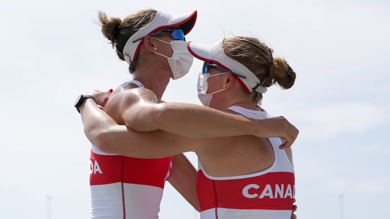 Canada's Caileigh Filmer and Hillary Janssens embrace after their bronze medal win in the women's pair rowing final event during the Tokyo Summer Olympic Games, in Tokyo, Thursday, July 29, 2021. THE CANADIAN PRESS/Nathan Denette