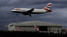 A plane comes in to land at Heathrow Airport in London, Friday, Feb. 5, 2021. (AP Photo/Kirsty Wigglesworth)