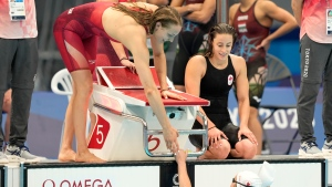 Canada's women's 4x200-metre freestyle relay team react following their heat at the 2020 Summer Olympics, Wednesday, July 28, 2021, in Tokyo, Japan. (AP Photo/Martin Meissner)