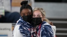 Simone Biles poses with teammate Mykayla Skinner as they watch the artistic gymnastics men's all-around final at the 2020 Summer Olympics, July 28, 2021, in Tokyo. (AP Photo/Ashley Landis)