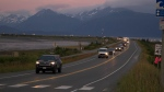 A line of cars evacuates the Homer Spit in Homer, Alaska on July 28, 2021, after a tsunami warning was issued following a magnitude 8.2 earthquake. (Sarah Knapp/Homer News via AP)