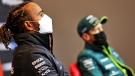 Aston Martin driver Sebastian Vettel, right, sits by Mercedes driver Lewis Hamilton during a press conference, on April 16, 2021. (Xpbimages / Pool via AP)