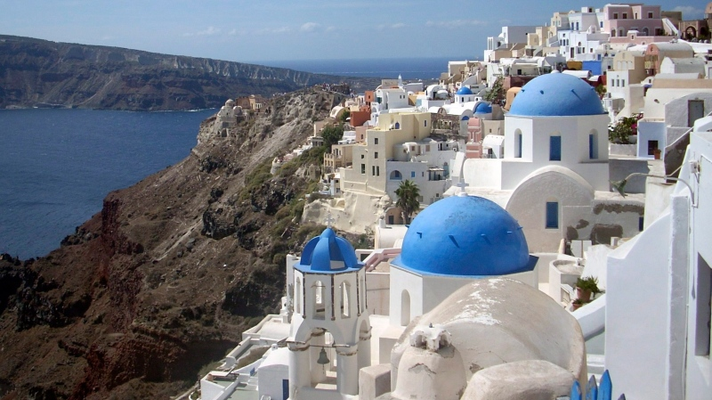 This Sept. 21, 2009, file photo, shows a view of Oia village on the island of Santorini, Greece. AP Photo/Michael Virtanen, File)