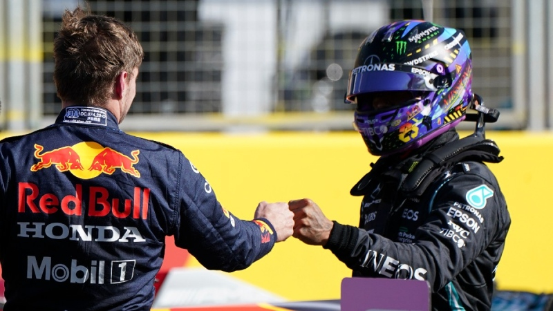 Red Bull driver Max Verstappen of the Netherlands, left, fist bumps with Mercedes driver Lewis Hamilton of Britain after the Sprint Qualifying of the British Formula One Grand Prix, at the Silverstone circuit, on July 17, 2021. (Jon Super / AP)