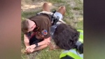 Warning: Texas officer pins woman during arrest