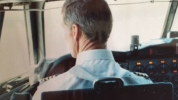 Captain Bob Barrett looks out on the airstrip prior to a flight. (Courtesy: Regina Barrett)