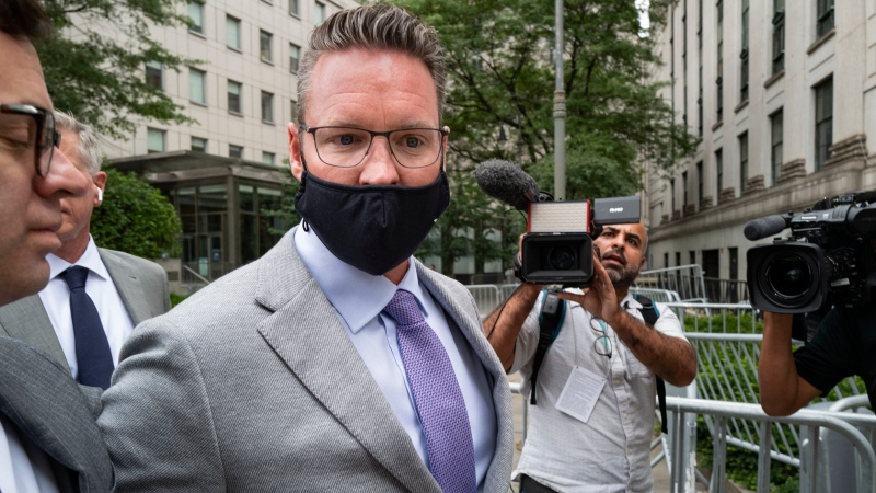 Nikola founder Trevor Milton leaves a federal courthouse in New York Thursday, July 29, 2021, after being charged with three counts of criminal fraud for lying to bolster stock sales of the electric vehicle start-up, according to an indictment unsealed Thursday. (AP Photo/Craig Ruttle)