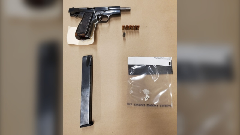 Airdrie RCMP seized a loaded pistol, a prohibited magazine and a quantity of drugs during a traffic stop on July 25. (Supplied)