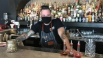 Mark Dutka is thrilled to be back behind the bar of his business, Maiden Lane Wine & Spirits, in downtown Windsor, Ont. on Thursday, July 29, 2021.. (Michelle Maluske/CTV Windsor)