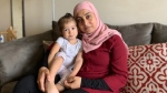 Ola Dahman, with her nearly two-year-old daughter Layan, inside their London,Ont. apartment, Thursday, July 29, 2021. (Reta Ismail / CTV News)
